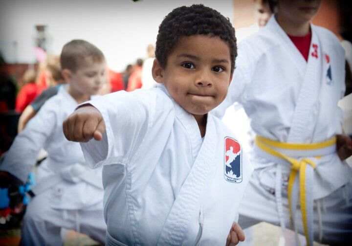 Boy practicing his punches in a CBK uniform
